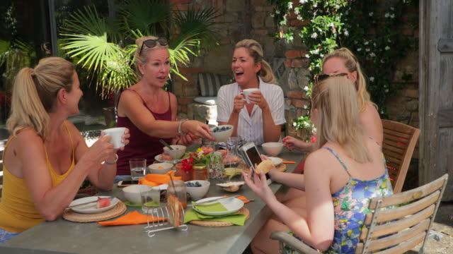 family breakfast outdoors - holiday villa stock videos & royalty-free footage