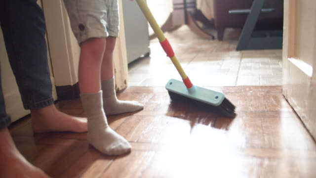 family brushing floor at home - cleaning stock videos & royalty-free footage