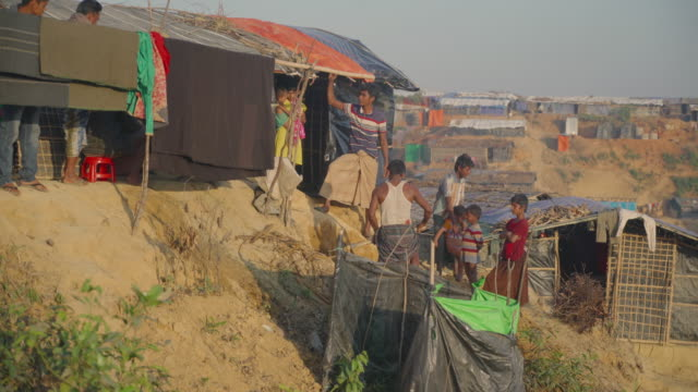 A family builds a latrine in Kutupalong refugee camp in Bangladesh Fleeing persecution by the Myanmar government and Rakhine vigilantes the Muslim...