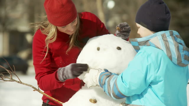 Family builds a snowman