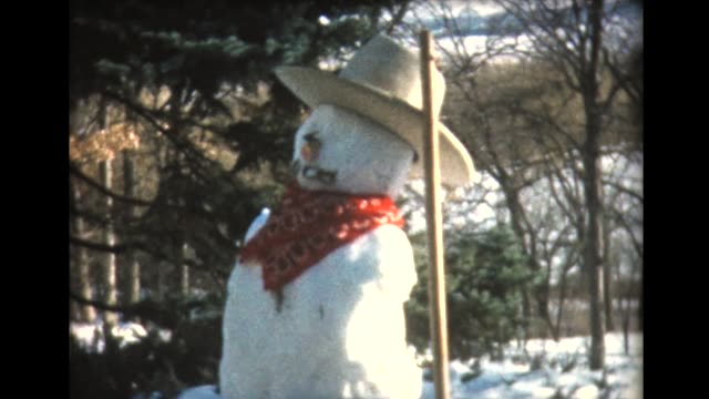 1960 family builds snowman