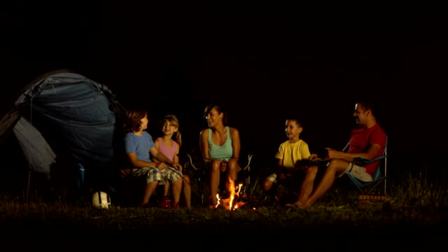 hd dolly: family camping at night - family with three children stock videos & royalty-free footage