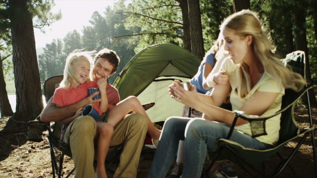 ms of family camping by lake - family with three children stock videos & royalty-free footage