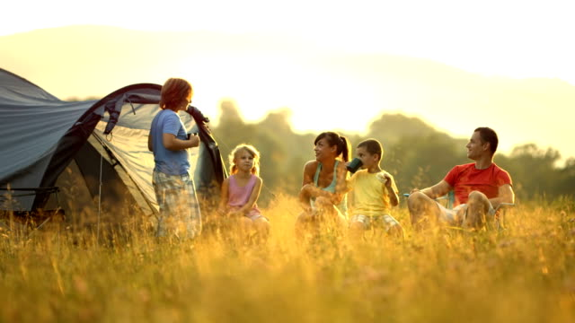 hd dolly: family camping in meadow - camping stock videos and b-roll footage