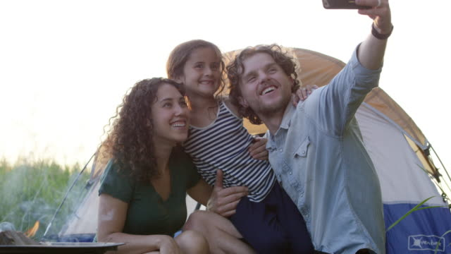family camping selfie - camping stock videos and b-roll footage