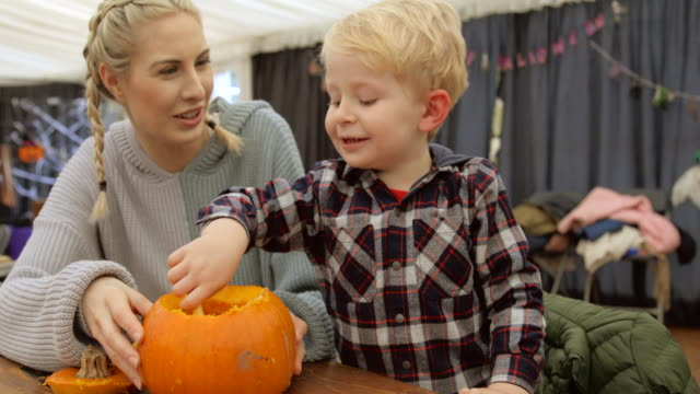 family carving pumpkins - carving craft product stock videos & royalty-free footage