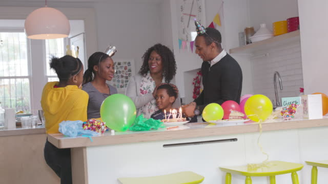 a family celebrating a birthday at home - birthday gift stock videos & royalty-free footage