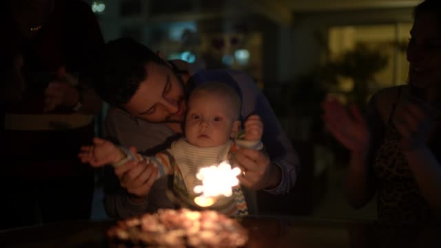 family celebrating a birthday at home - affectionate stock videos & royalty-free footage