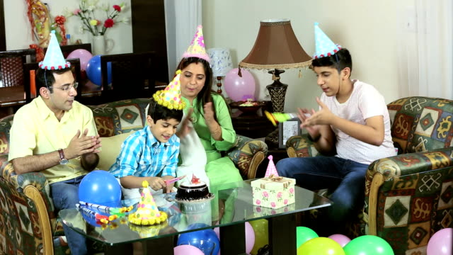 Family celebrating birthday at home, Delhi, India