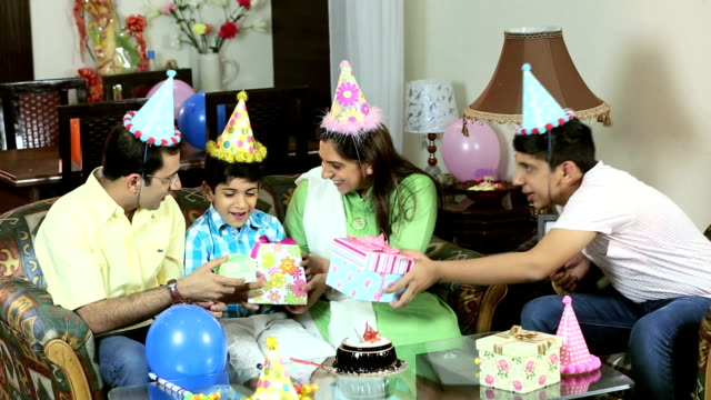 family celebrating birthday at home, delhi, india - party hat stock videos and b-roll footage