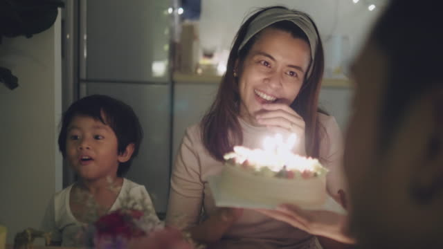 family celebrating birthday party at home - birthday candle stock videos & royalty-free footage
