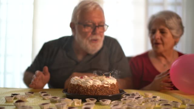family celebrating birthday party - grandfather stock videos & royalty-free footage