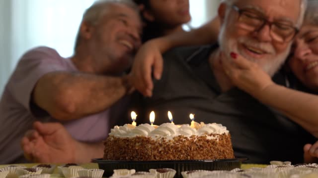 family celebrating birthday party - 60 69 years stock videos & royalty-free footage