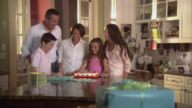 MS Family celebrating daughter's (10-11) birthday in dining room / Jacksonville, Florida, USA