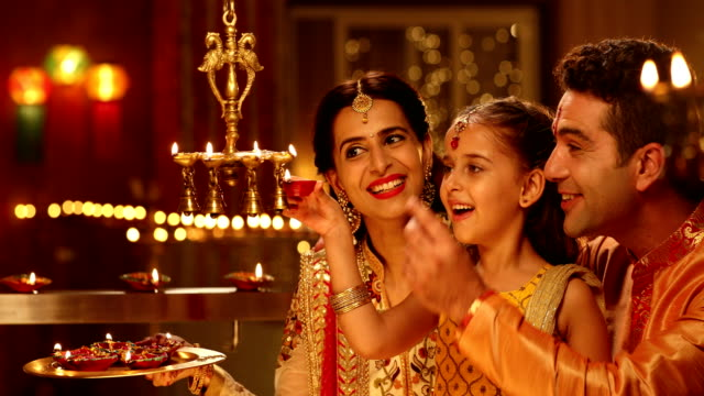 family celebrating diwali festival, delhi, india - celebration stock videos & royalty-free footage