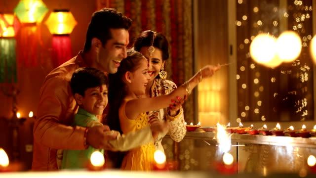 family celebrating diwali festival, delhi, india - sari stock videos & royalty-free footage