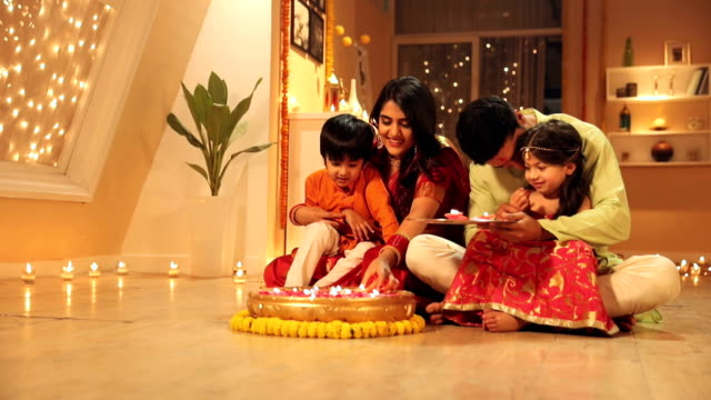 family celebrating diwali festival in the home, delhi, india - votive candle stock videos and b-roll footage