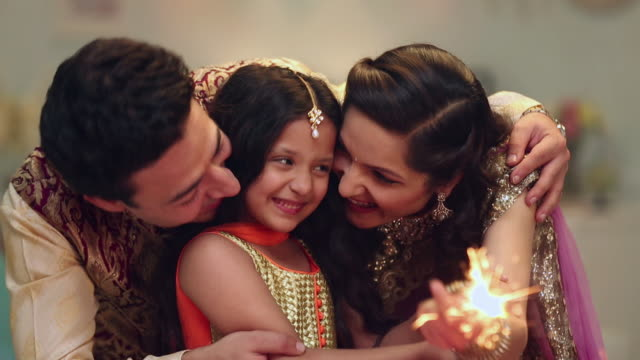 family celebrating diwali festival - two parents stock videos & royalty-free footage