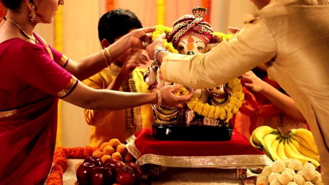 Family celebrating Ganesh Chaturthi, Delhi, India