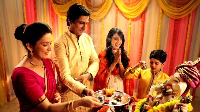 family celebrating ganesh chaturthi, delhi, india - god stock videos and b-roll footage