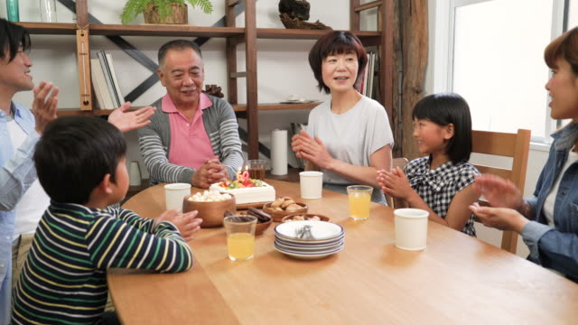 family celebrating grandfather's birthday - multi generation family stock videos & royalty-free footage