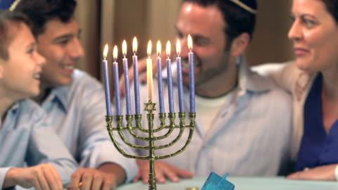 family celebrating hanukkah - religion stock videos & royalty-free footage
