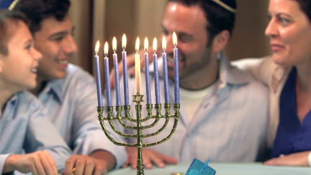 family celebrating hanukkah - religion stock videos & royalty-free footage
