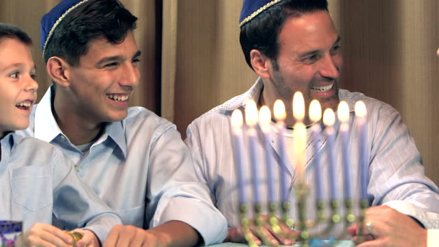 family celebrating hanukkah - religious celebration stock videos & royalty-free footage