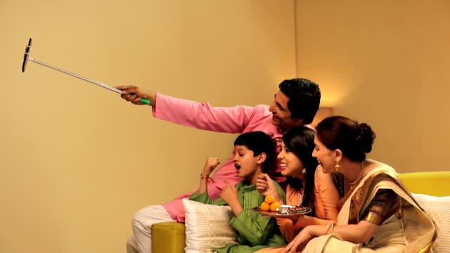 family celebrating raksha bandhan, delhi, india - pigiama video stock e b–roll