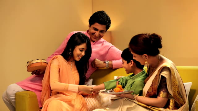 Family celebrating Raksha Bandhan, Delhi, India