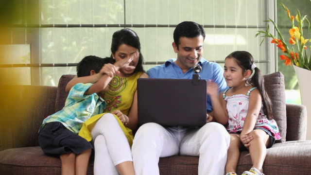 family chatting on a laptop  - two parents stock videos & royalty-free footage