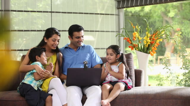 family chatting on a laptop  - little girl webcam stock videos & royalty-free footage