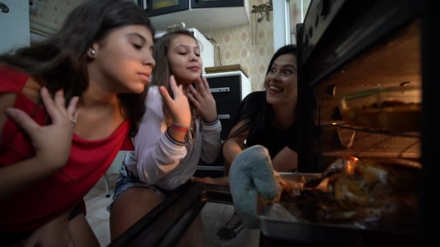 family checking the traditional turkey for christmas dinner - waiting stock videos & royalty-free footage