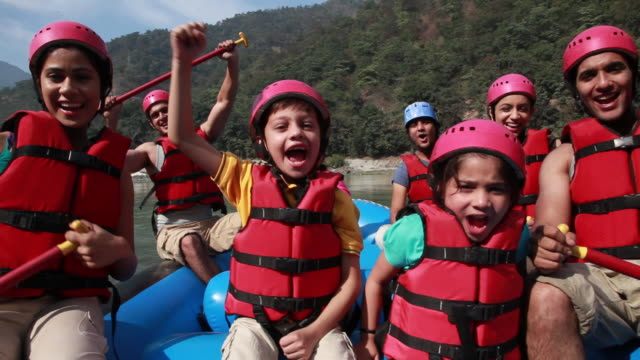 family cheering at river rafting  - helmet stock videos & royalty-free footage