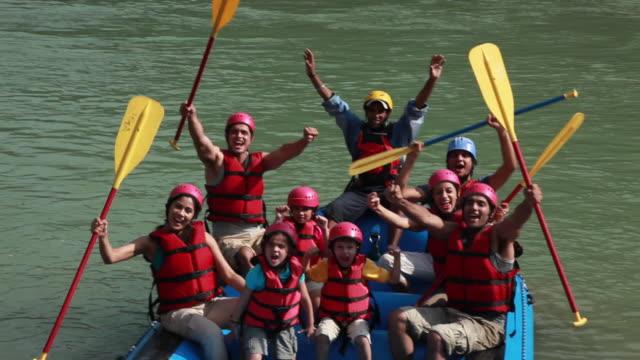 Family cheering at river rafting