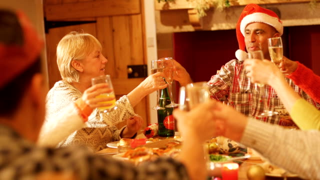family cheering at the dinner table - christmas tree stock videos and b-roll footage