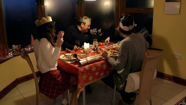 family christmas dinner - cracker stock videos and b-roll footage