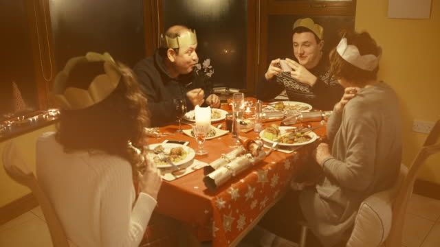 family christmas dinner - christmas cracker stock videos and b-roll footage