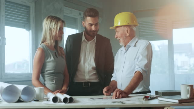 Family consulting with a architect