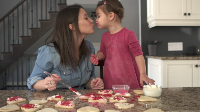 family cooking some cookies on kitchen counter daughter and mother - messy stock videos & royalty-free footage