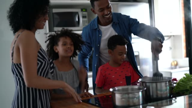 family cooking together and dancing at kitchen - two parents stock videos & royalty-free footage