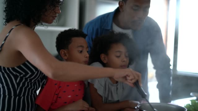 family cooking together at kitchen - afro stock videos & royalty-free footage