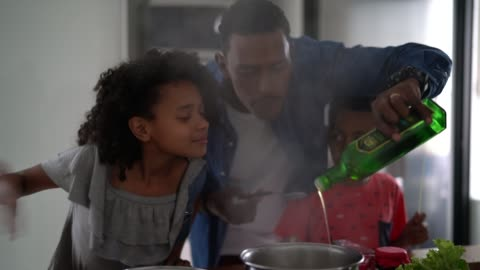 family cooking together at kitchen - cooking stock videos & royalty-free footage