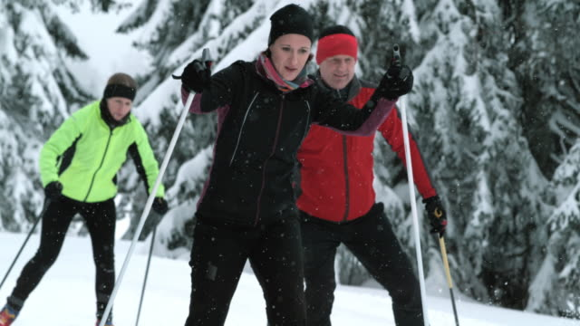 Family cross country skiing in nature