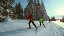 TS SLO MO family cross country skiing on sunny day