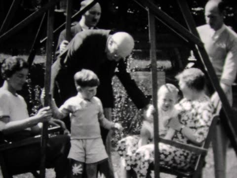 1931 family crowds into large swing