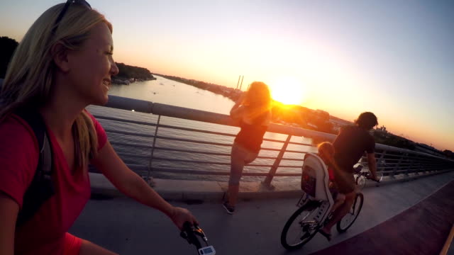 family cycling in the city together at sunset - outdoor pursuit stock videos & royalty-free footage