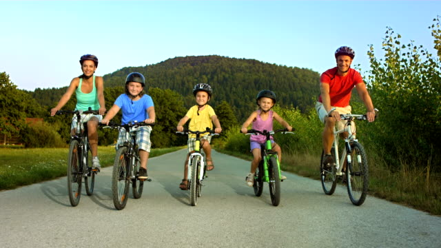 hd: family cycling in the countryside - cycling helmet stock videos & royalty-free footage