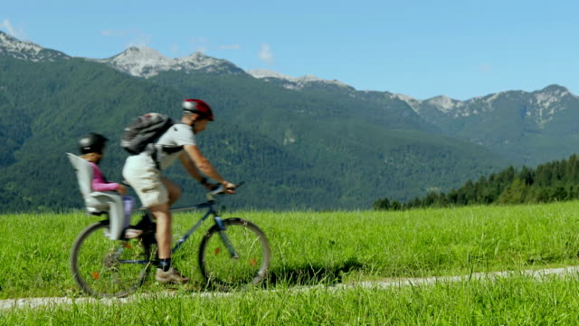 hd: family cycling in the countryside - bicycle seat stock videos & royalty-free footage