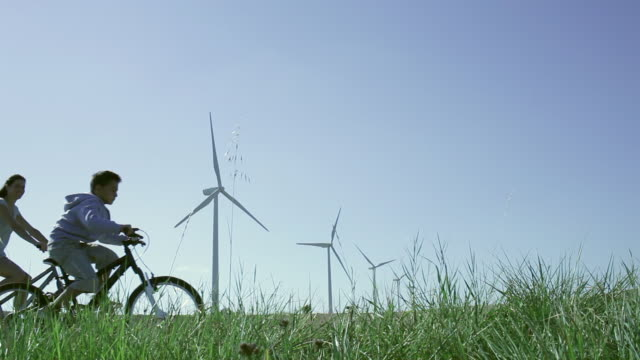 ms family cycling in wind farm / toulouse, midi-pyrenees, france - cycling stock videos & royalty-free footage